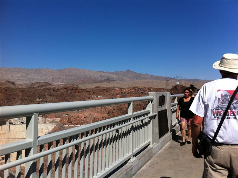 Paul walks down the center of the pedestrian bridge across the new Hoover Dam bypass bridge.
