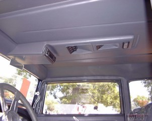 An overhead console can clean up your floor, allowing you to mount things like a CD player, and some little cubbys.