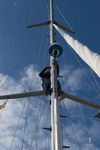 climbing the mast of a sailing boat