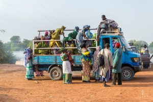 Colourful women in Gambia jumping in a truck