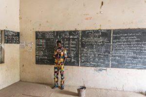 Senegalse Teacher in front of the class room in Senegal
