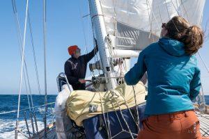 Hoisting the sails on a sailing boat