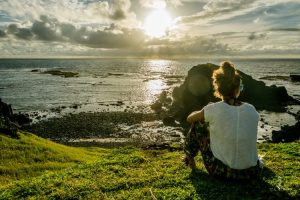 Girl watching sunrise in Fernando de Noronha