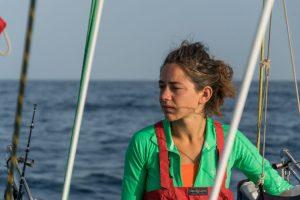 Sailing girl on the ocean