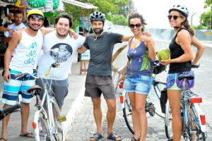 Group of cyclists drinking coconut water