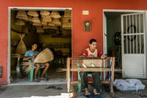 Basket weavers working in a workshop in Brazil