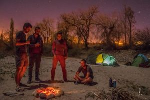 Friends having a campfire in Argentina