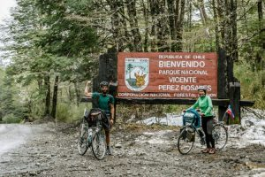 Two cyclists crossing the border to Chile on the Cruce Andino