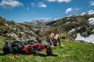 Hiker reading on Kobo eReader in the mountains