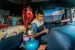 Truck driver boiling water inside the cabin