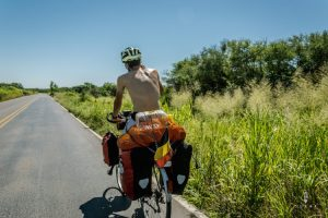 Cycling without shirt in El Chaco Paraguay