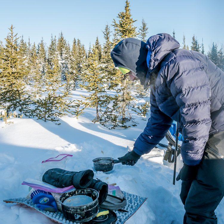 preparing breakfast in snow