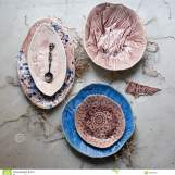 different-antique-vintage-multicolored-empty-plates-bowls-white-old-wooden-table-table-setting-shabby-chic-retro-style-89305237