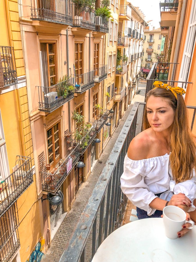 Woman Enjoys Cup of Coffee in Valencia