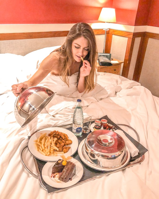 Woman Orders Room Service in Barcelona