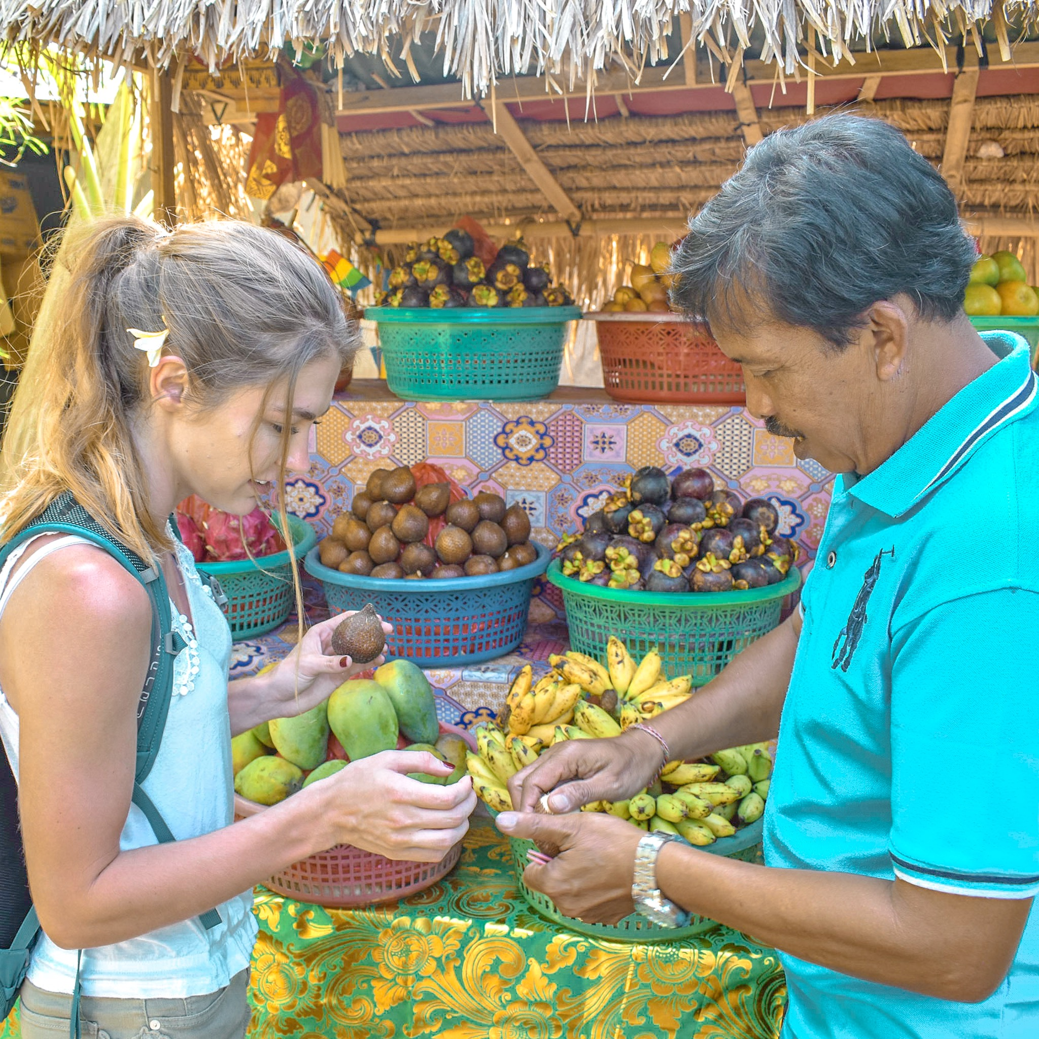 Woman Learns About the Native Fruits in Bali