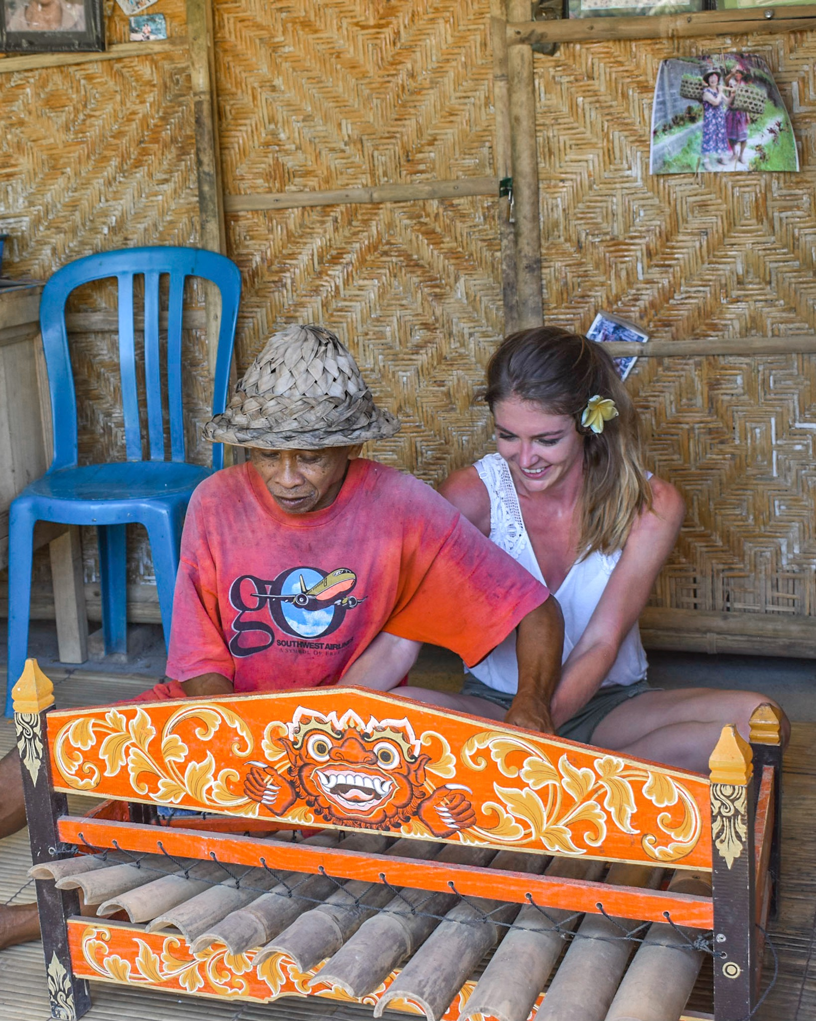 Man Teaches Woman to Play Handmade Xylophone in Bali, Indonesia