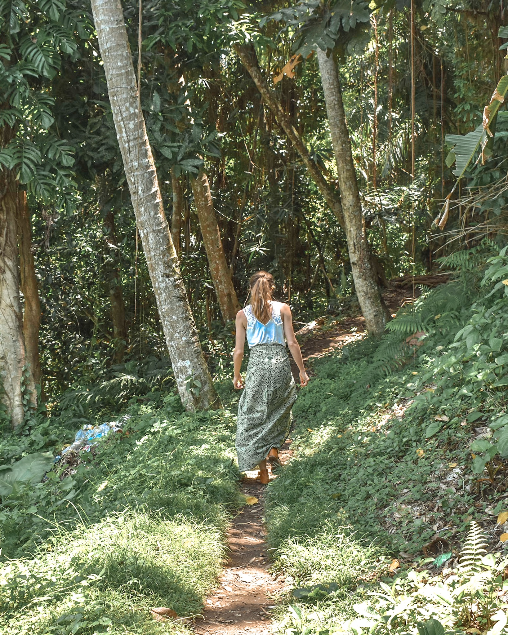 Woman Walks Through Jungle in Bali, Indonesia