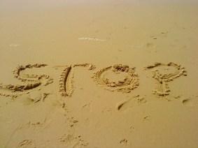 stop - sand-404047_1280