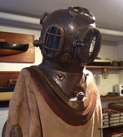 1920's deep sea diving suit, complete with lead shoes and air pump, just needs air hoes and a man of steel!
