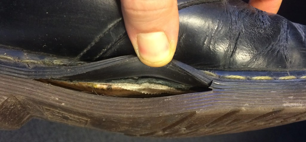 Soles split lengthwise on almost unused Dr Martens.