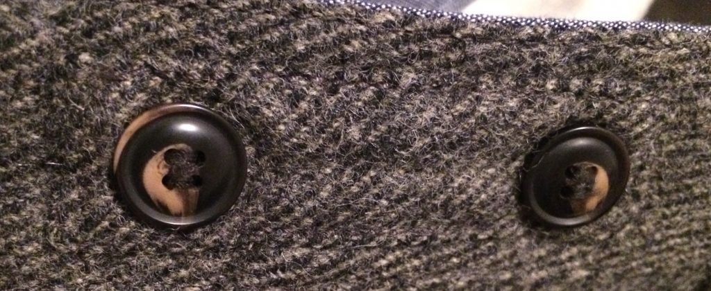 Properly reinforced buttons on a pair of H&M tweed trousers.