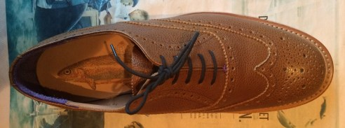 Laced in a more proper way for decent shoes, with an attempt at a Turkish Cable Knot.