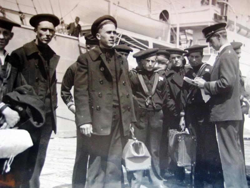 A vintage photo of the pea coat as used by the navy boys in WW2.y