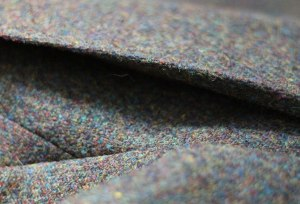A detail of the back, showing how it can expand and make more room when needed, a feature of the Norfolk jacket.