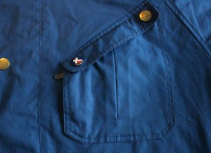 Chest pocket with both brass studs and a quick entry RIRI zip.