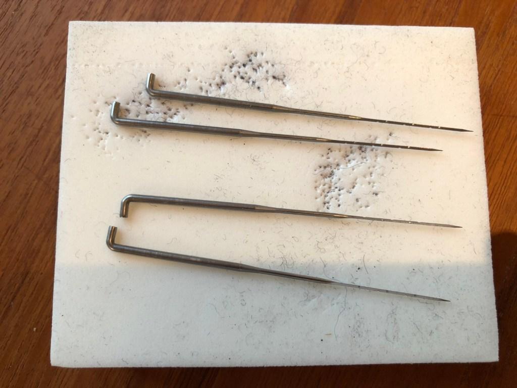 Barbed felting needles and styrofoam block.
