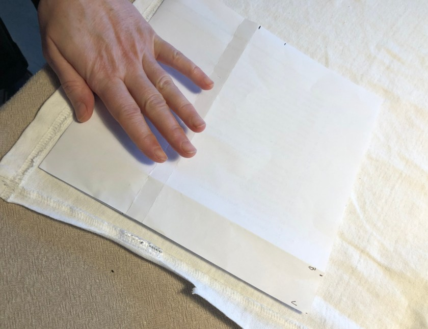 Start out by cutting a 22 by 21 cm square. Where the larger measurement is up and the shorter is across. This is to get the flex of the fabric in the right direction. If you feel how a t-shirt stretches, you'll notice it flexes more outwards (to allow for a big dinner) than in length (which is less required).