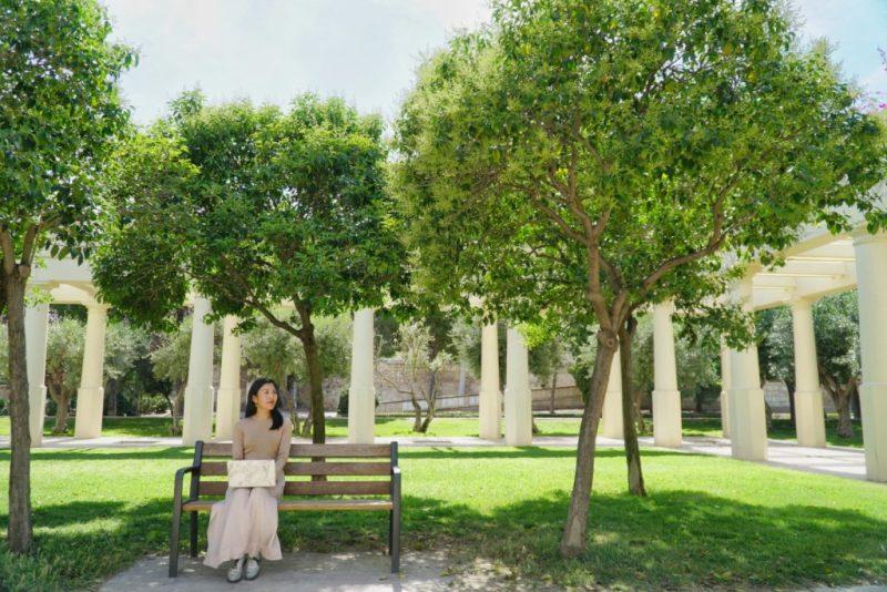 woman looking optimistic under trees