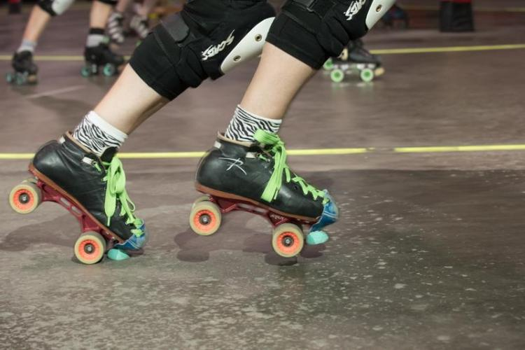 photo of a person's feet wearing Riedell quad skates