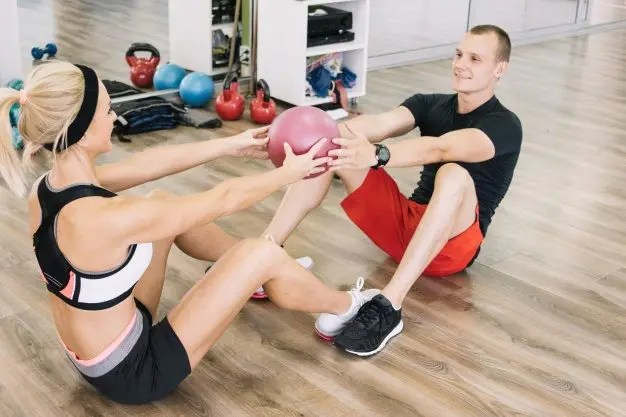 man and woman doing exercises