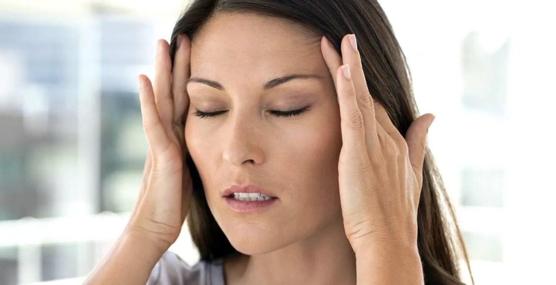 migraine lady grabbing temples