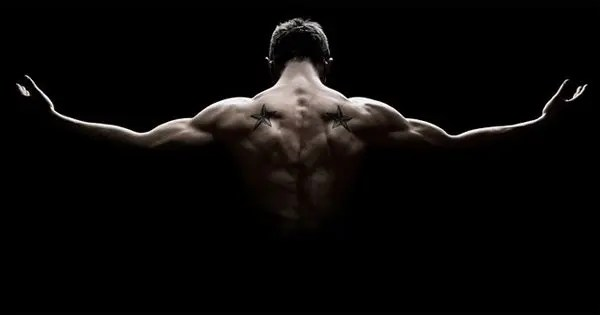 blog picture of man flexing his back