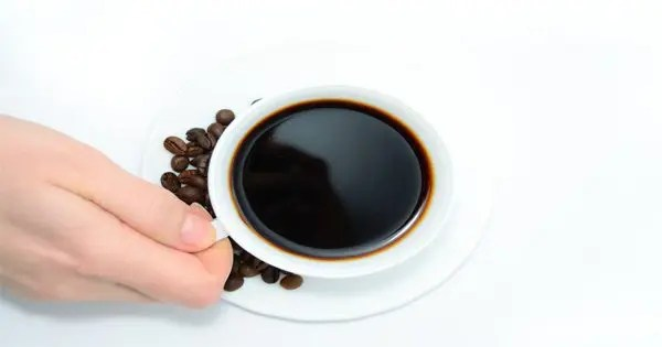 blog picture of hand grabbing a cup of coffee