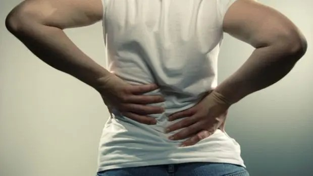 blog picture of a man grabbing his back in pain