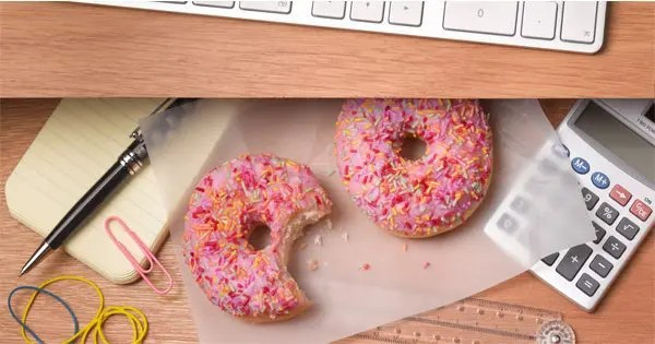 blog picture of office area calculator and donuts