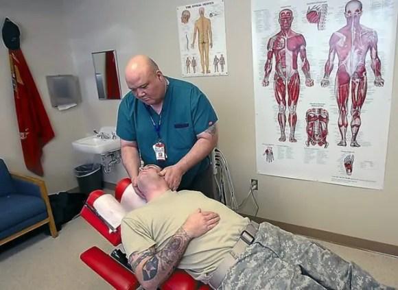 PTSD veteran receiving chiropractic treatment