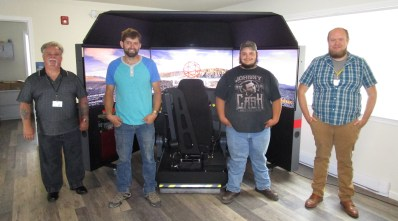 Group of students and instructors with the driving simulator