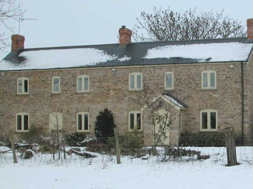 The Front Elevation of The Dusthouses in the snow