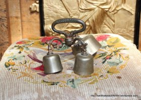 Some kind of ceremonial bells with their own pillow