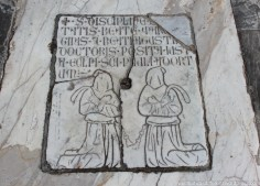 Flagellants on a tombstone are slightly Monty Python-esque.