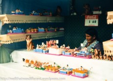 Selling good-luck miniatures at the Alacitas market.