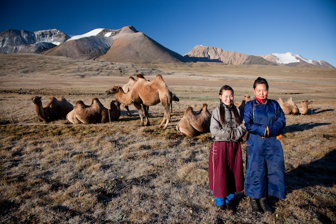 Bactrian camels and local people. Image World Expeditions.