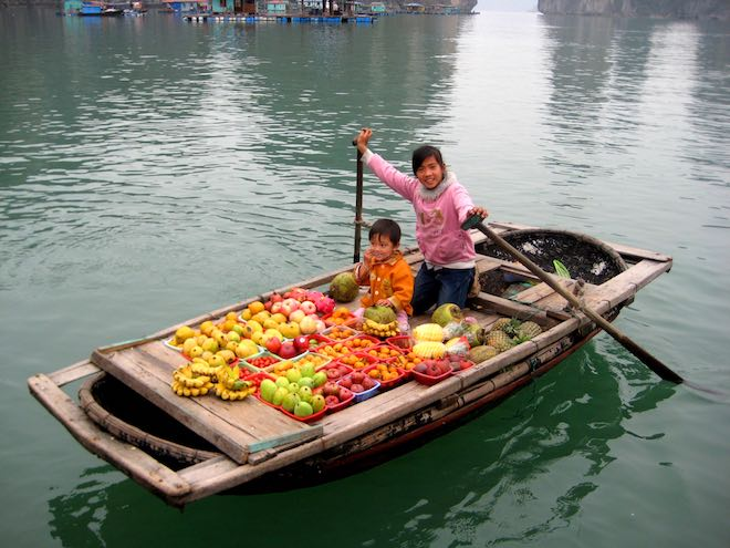 Local villagers selling fruit and vegetables to locals and tourists.