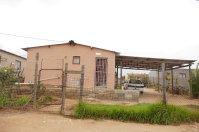 """""""Mandela-Häuser"""" in den Townships. Der ehemalige Präsident hat jedem Südafrikaner ein Haus versprochen..."""