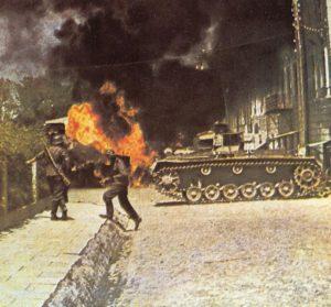 Deutsche Infanterie und ein PzKpfw III im Strassenkampf